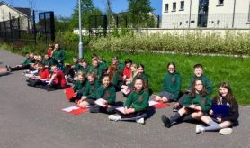 Mr Masters' class conducting a traffic survey in the sunshine